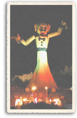 Zozobra is about to start, as the Fire Dancers gather at the base of the 50-foot effigy. The Zozobra event takes places every September in Santa Fe, New Mexico.